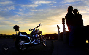 biker couple sunset