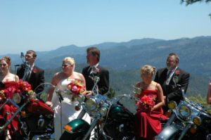 a group wedding of couples of old bikers